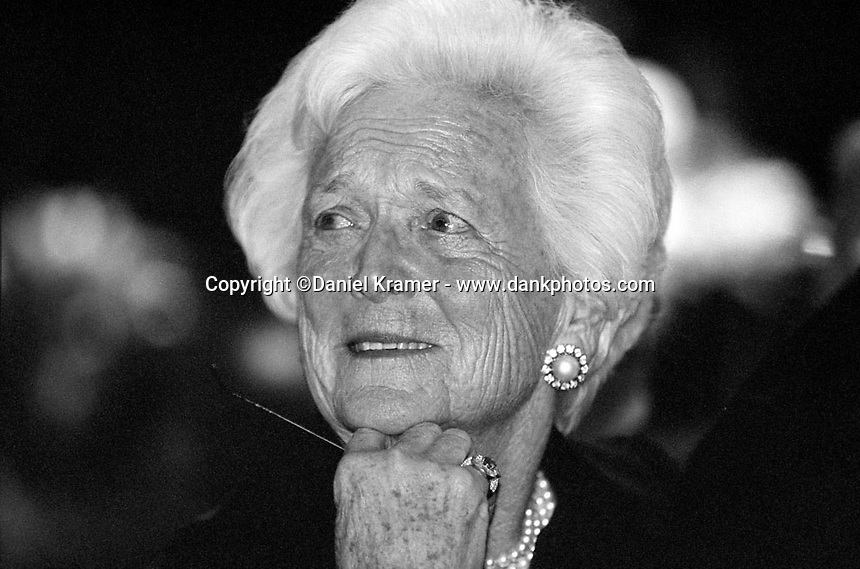 Former First Lady Barbara Bush looks on as her husband delivers a speech at the Rotary Club's Annual Lombardi Award presentation at Reliant Stadium in 2002.