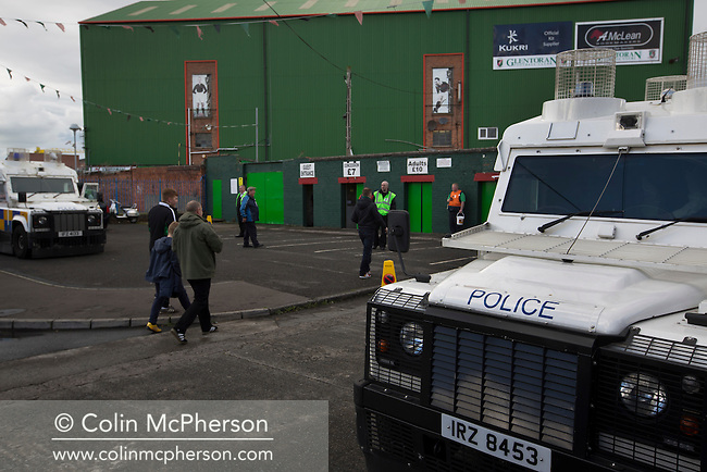 Police Service of Northern Ireland officers on duty as home fans arrive at The Oval, Belfast before Glentoran hosted city-rivals Cliftonville in an NIFL Premiership match. Glentoran, formed in 1892, have been based at The Oval since their formation and are historically one of Northern Ireland's 'big two' football clubs. They had an unprecendentally bad start to the 2016-17 league campaign, but came from behind to win this fixture 2-1, watched by a crowd of 1872.