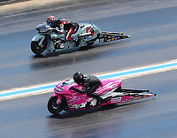 Jul 23, 2017; Morrison, CO, USA; NHRA pro stock motorcycle rider Jerry Savoie (near) races alongside Cory Reed during the Mile High Nationals at Bandimere Speedway. Mandatory Credit: Mark J. Rebilas-USA TODAY Sports