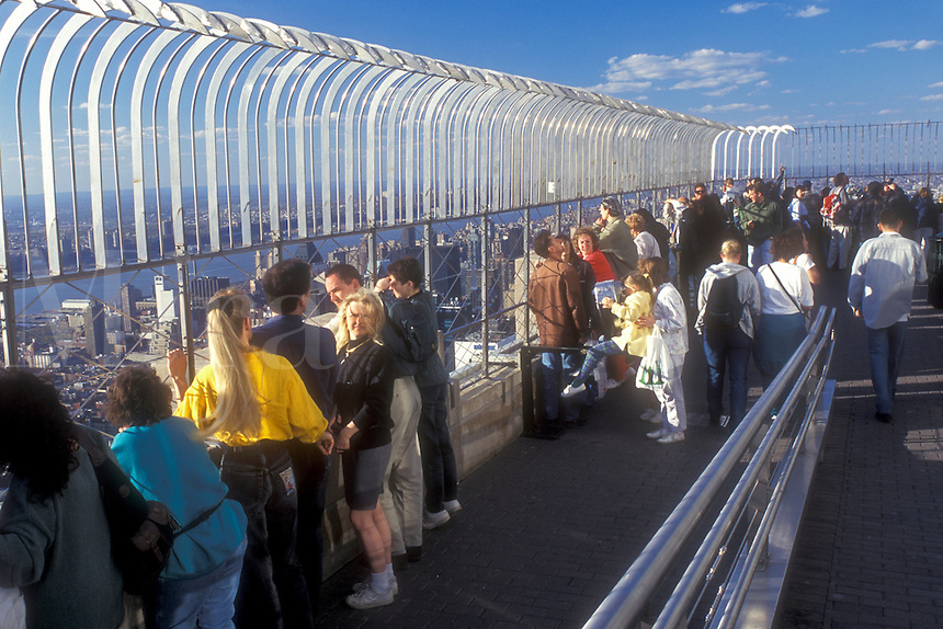 AJ1265, New York City, Empire State Building, Manhattan, New York, N.Y.C., Tourists viewing New York City, New York from the outdoor Observation Deck of the Empire State Building in Midtown Manhattan.