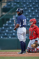 Bryan Torres (12), of the AZL Padres 1, at bat during an Arizona League game against the AZL Angels on August 5, 2019 at Tempe Diablo Stadium in Tempe, Arizona. AZL Padres 1 defeated the AZL Angels 5-0. (Zachary Lucy/Four Seam Images)