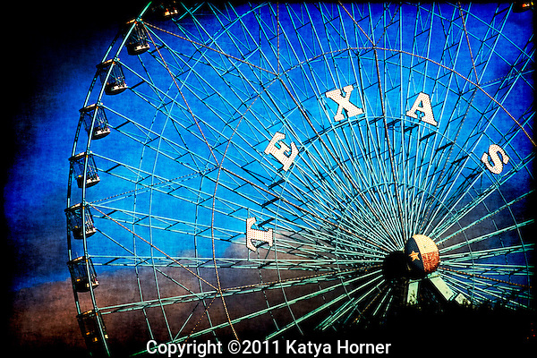 The ferris wheel at Fair Park in Dallas, Texas.  Taken at sunset, following a strong rain.