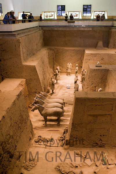 Tourists view Pit 3 containing horses and warriors as they were found, at Qin Museum of Terracotta Warriors, China