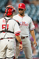 Philadelphia Phillies pitcher Antonio Bastardo #37 talks with catcher Carlos Ruiz #51 during the Major League baseball game against the Houston Astros on September 16th, 2012 at Minute Maid Park in Houston, Texas. The Astros defeated the Phillies 7-6. (Andrew Woolley/Four Seam Images).