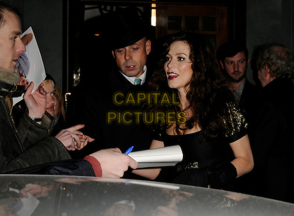 ANNA FRIEL .At The Ivy Restaurant, London, England,.February 2nd 2008..half length getting into car red lipstick fan autograph.CAP/CAN.?Can Nguyen/Capital Pictures