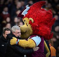 Steve Bruce, manager of Aston Villa embraces the club mascot Hercules the Lion during the Sky Bet Championship match between Aston Villa and Birmingham City at Villa Park, Birmingham, England on 11 February 2018. Photo by Bradley Collyer/PRiME Media Images.