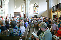 Audience settling in for performances by Seckou Keita and Carmen Souza, St Mary's Church, Petworth Festival, West Sussex.