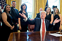 United States President Donald Trump, center, responds to a question while meeting with the crew and passengers of Southwest Airlines Co. flight 1380 in the Oval Office of the White House in Washington, D.C., U.S., on Tuesday, May 1, 2018. An engine on Southwest's flight 1380, a Boeing Co. 737-700 bound for Dallas from New York's LaGuardia airport, exploded and made an emergency landing on April 17 sending shrapnel into the plane and killing a passenger seated near a window. <br /> Credit: Andrew Harrer / Pool via CNP /MediaPunch