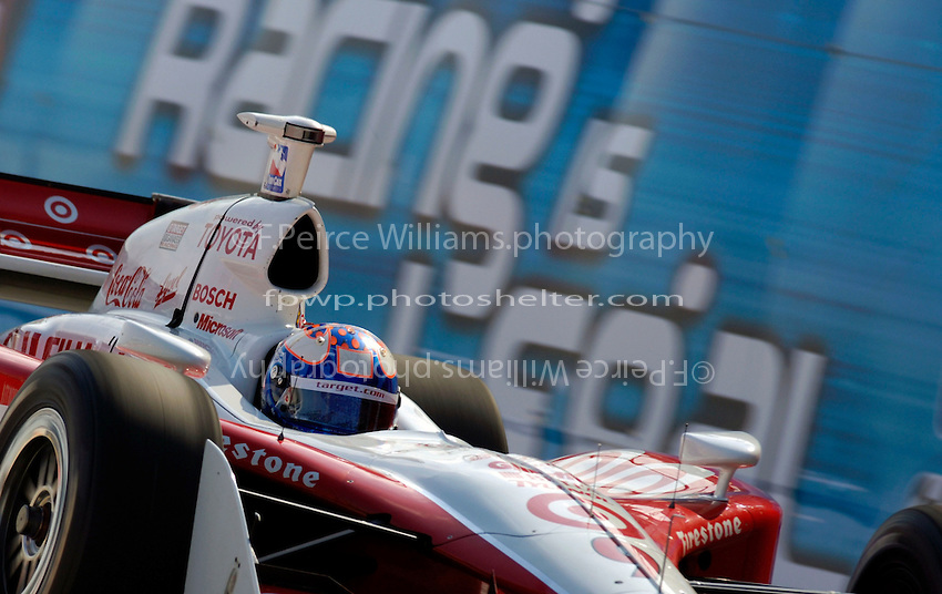 "Grand Prix of St. Petersburg, 3 April, 2005.Scott Dixon flashes past the ""Street Racing is Legal"" signage alongside the track..Copyright©F.Peirce Williams 2005.  ref.Digital Image Only"