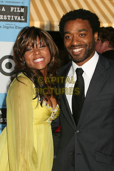 "TARAJI P. HENSON & CHIWETEL EJIOFOR.""Talk To Me"" LA Film Festival Screening at Mann's Village Theatre, Westwood, California, USA..June 21st, 2007.half length yellow sheer dress grey grey suit beard facial hair .CAP/ADM/BP.©Byron Purvis/AdMedia/Capital Pictures"
