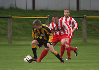 Jason Coyle on the ball watched by Scott Forrester in the Huntly v Wigtown & Bladnoch William Hill Scottish Cup 1st Round match, at Christie Park, Huntly on 25.8.12.