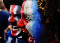 Costa Rica supporters make gests during the soccer World Cup match between Costa Rica and Greece<br />