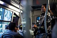 A man sings for money inside of a public transport in Bogota, Colombia. 29/02/2012.  Photo by Eduardo Munoz Alvarez / VIEWpress.