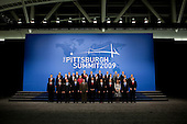 Pittsburgh, PA - September 25, 2009 -- United States President Barack Obama and G-20 Summit world leaders gather for the official photo at the David L. Lawrence Convention Center, Pittsburgh, Pennsylvania, September 25, 2009. The world leaders are, from left to right from front to back; South African President Kgalema Motlanthe, South Korean President Lee Myung-Bak, French President Nicolas Sarkozy, Indonesian President Susilo Bambang Yudhoyono, Brazilian President Luiz Inacio Lula de Silva, President Barack Obama, Chinese President Hu Jintao, Mexican President Felipe Calderon, Argentine President Cristina Fernandez de Kirchner, Russian President Dmitry Medvedev, Canadian Prime Minister Steven Harper, Saudi Foreign Minister Prince Saud al-Faisal, Japanese Prime Minister Yukio Hatoyama, Australian Prime Minister Kevin Rudd, Sweden Prime Minister John Fredrik Reinfeldt, German Chancellor Angela Merkel, United Kingdom Prime Minister Gordon Brown, Turkish Prime Minister Recep Tayyip Erdogan, Indian Prime Minister Mommohan Singh, Dutch Prime Minister Jan Peter Balkenende, Spanish Prime Minister Jose Luis Rodriguez Zapatero, Italian Prime Minister Silvio Berlusconi, EU President Jose Manuel Barroso, Singapore Finance Minister Tharman Shanmugaratnam, Thai Prime Minister Abhisit Bejjajiba represent ASEAN, Managing director of the International Monetary Fund, Dominique Strauss-Kahn, Director General of the ILO Juan Somavia, UN Secretary-General Ban Ki-moon, World Bank President Robert Zoellick, Secretary General of the OECD Angel Gurria, World Trade Organization Director General Pascal Lamy, Governor of the Banca d'Italia Mario Draghi representing the Financial Stability Board. .Mandatory Credit: Samantha Appleton - White House via CNP