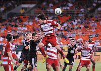 FC Dallas defender Heath Pearce (4) head the ball.  FC Dallas defeated DC United 3-1 at RFK Stadium, Saturday August 14, 2010.