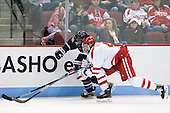 Max Kalter (UConn - 18), Brandon Hickey (BU - 4) - The Boston University Terriers defeated the visiting University of Connecticut Huskies 4-2 (EN) on Saturday, October 24, 2015, at Agganis Arena in Boston, Massachusetts.