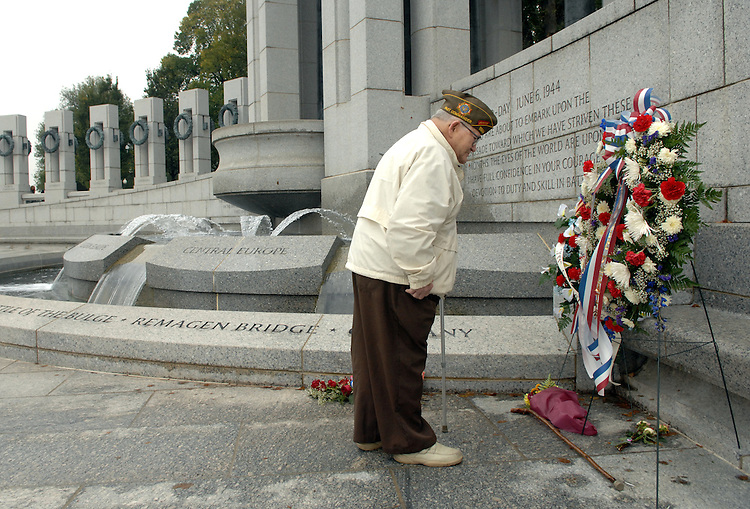 World War II veteran Donald Napier of Syracuse, views a wreath near the European campaign section of the World War II Memorial, on Monday, the federal observation of Veteran's Day.  Napier served in an Army unit of engineers that invaded Normandy on D-Day.