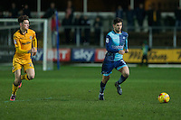 Joe Jacobson of Wycombe Wanderers gets away from Tom Owen-Evans of Newport County during the Sky Bet League 2 match between Newport County and Wycombe Wanderers at Rodney Parade, Newport, Wales on 22 November 2016. Photo by Mark  Hawkins.