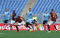 Calcio, Serie A: Roma vs Lazio. Roma, stadio Olimpico, 8 novembre 2015.<br /> Roma's Mohamed Salah, left, is challenged by Lazio's Lucas Biglia during the Italian Serie A football match between Roma and Lazio at Rome's Olympic stadium, 8 November 2015.<br /> UPDATE IMAGES PRESS/Isabella Bonotto