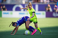 Orlando, Florida - Sunday, May 8, 2016: Orlando Pride midfielder Samantha Witteman (26) tackles the ball away from Seattle Reign FC midfielder Kim Little (8) during a National Women's Soccer League match between Orlando Pride and Seattle Reign FC at Camping World Stadium.