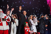United States President Barack Obama (C) waves from the stage  during the 91st National Christmas Tree Lighting Ceremony on the Ellipse south of the White House in Washington, DC, USA, 06 December 2013. The lighting of the tree is an annual tradition attended by the US President and the First Family. President Calvin Coolidge lit the first National Christmas tree, a 48-foot Balsam fir, in 1923.<br /> Credit: Jim LoScalzo / Pool via CNP