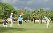 United States President Barack Obama, left, looks on as White House Aide Marvin Nicholson, right, putts on the 2nd green while golfing at the Marine Corps Base Hawaii's Kaneohe Klipper Golf Course.   Kaneohe, Hawaii. January 2, 2014. Prime Minister John Key of New Zealand's son Max Key, center, is holding the flag.<br /> Credit: Cory Lum / Pool via CNP