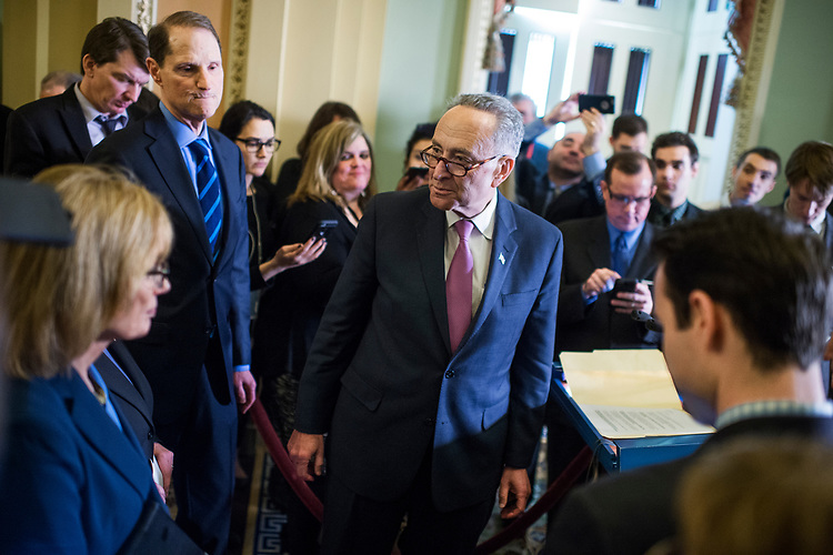UNITED STATES - MARCH 7: Senate Minority Leader Charles Schumer, D-N.Y., Ron Wyden, D-Ore., and Maggie Hassan, D-N.H., arrive for a news conference after Senate Policy luncheons in the Capitol where they made remarks on the House Republican's new healthcare plan, March 7, 2017. (Photo By Tom Williams/CQ Roll Call)