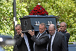 Coffin complete with The black coffin had an AC/DC lightning motif on the frontt at the funeral of Stuart Cable at St Elvan's Church in the centre of Aberdare today. The former Stereophonics drummer was found dead at his home on 7th June.