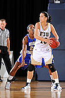 12 January 2012:  FIU guard Fanni Hutlassa (10) handles the ball while being defended by Middle Tennessee State guard-forward Ebony Rowe (21) as the Middle Tennessee State University Blue Raiders defeated the FIU Golden Panthers, 74-60, at the U.S. Century Bank Arena in Miami, Florida.