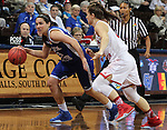 SIOUX FALLS MARCH 22:  Kelsey Hoppel #23 of Lubbock Christian dribbles past Flo Ward #4 of Florida Southern during their quarterfinal game at the NCAA Women's Division II Elite 8 Tournament at the Sanford Pentagon in Sioux Falls, S.D. (Photo by Dick Carlson/Inertia)