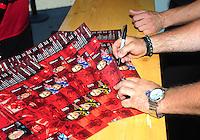 Jun. 17, 2011; Bristol, TN, USA: NHRA top fuel dragster driver Shawn Langdon sign autographs during qualifying for the Thunder Valley Nationals at Bristol Dragway. Mandatory Credit: Mark J. Rebilas-