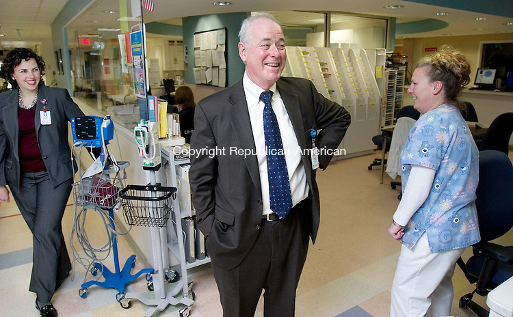 WATERBURY, CT. 12 April 2010-041210SV05--From left, Elizabeth Longmore, Director Emergency Services, listens as John Tobin, President and CEO of Waterbury Hospital, talks with Casey Longo, ER Tech. during a recent visit to the Emergency Department at Waterbury Hospital in Waterbury Monday. Tobin will be retiring at the end of the year.<br /> Steven Valenti Republican-American