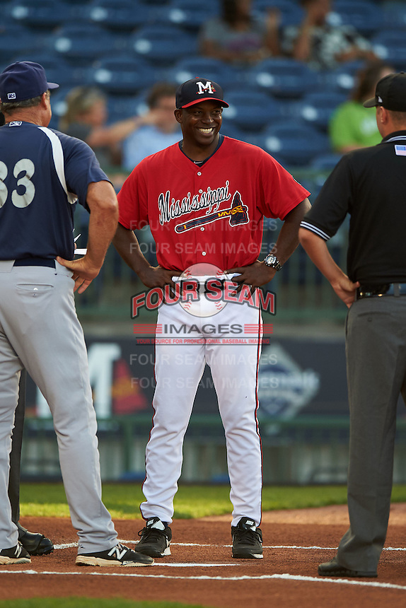 Mississippi Braves manager Aaron Holbert (13) during the lineup exchange before a game against the Pensacola Blue Wahoos on May 28, 2015 at Trustmark Park in Pearl, Mississippi.  Mississippi defeated Pensacola 4-2.  (Mike Janes/Four Seam Images)