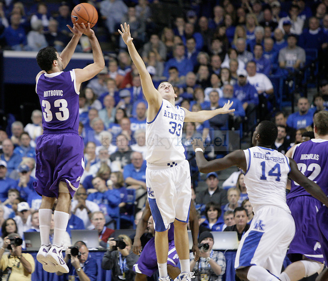 Kyle Wiltjer attempts to block a three-point shot against Portland at Rupp Arena on Saturday, Nov. 26, 2011. Photo by Scott Hannigan | Staff
