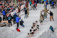 Rick Casillo runs down 4th avenue after leaving the start line in downtown during the Ceremonial Start of the 2016 Iditarod in Anchorage, Alaska.  March 05, 2016