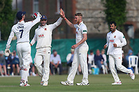 Jamie Porter of Essex is congratulated by his team mates after taking the wicket of Dominic Sibley during Surrey CCC vs Essex CCC, Specsavers County Championship Division 1 Cricket at Guildford CC, The Sports Ground on 11th June 2017