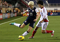 BOCA RATON, FL - DECEMBER 15, 2012: Megan Rapinoe (15) of the USA WNT chips the ball away from Zhang Rui (25) of China WNT during an international friendly match at FAU Stadium, in Boca Raton, Florida, on Saturday, December 15, 2012. USA won 4-1.