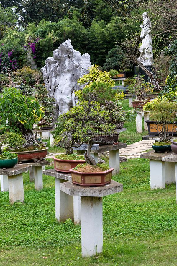 Guizhou Province, China.  Bonsai Garden, Yellow Fruit Tree (Huangguoshu) Waterfall Scenic Area.  Statue Honoring Xu Xiake (Xu Hongzu), 17th-century traveler, geologist, and scientist.