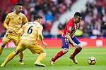Angel Correa (R) of Atletico de Madrid is tackled by Alex Granell Nogue (C) of Girona FC during the La Liga 2017-18 match at Wanda Metropolitano on 20 January 2018 in Madrid, Spain. Photo by Diego Gonzalez / Power Sport Images