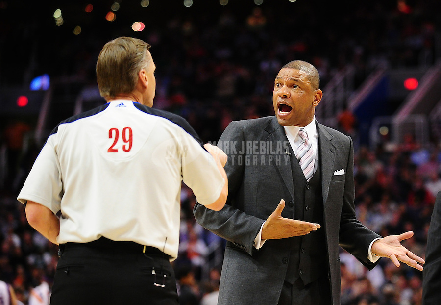 Jan. 28, 2011; Phoenix, AZ, USA; Boston Celtics head coach Doc Rivers argues with NBA official Steve Javie prior to being ejected while playing against the Phoenix Suns at the US Airways Center. Mandatory Credit: Mark J. Rebilas-