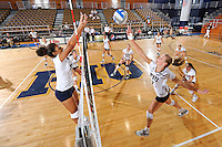 16 October 2010:  FIU's team (FIU middle blocker Briana Spruill (8)(left), outside hitter Una Trkulja (7)(right); also visible, defensive specialist Jessica Wilkie (15), libero Angelina Colon (4), right side hitter Ines Medved (11), setter Natalia Valentin (9), middle blocker Andrea Lakovic (1) and middle blocker Sabrina Gonzalez (12)) warms up prior to the match.  The Western Kentucky Hilltoppers defeated the FIU Golden Panthers, 3-2 (25-19, 23-25, 25-20, 25-27, 15-13), at the U.S Century Bank Arena in Miami, Florida.