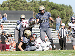 Palos Verdes, CA 09-07-18 - Mason O'Connor (Peninsula #24) and Jimmy Prahl (Torrance #4) and Diego Meraz (Torrance #33) in action during the Torrance - Palos Verdes Peninsula Varsity football game.
