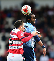 Blackpool's Nathan Delfouneso vies for possession with Doncaster Rovers' Mathieu Baudry<br /> <br /> Photographer Chris Vaughan/CameraSport<br /> <br /> The EFL Sky Bet League Two - Doncaster Rovers v Blackpool - Keepmoat Stadium - Doncaster<br /> <br /> World Copyright &copy; 2017 CameraSport. All rights reserved. 43 Linden Ave. Countesthorpe. Leicester. England. LE8 5PG - Tel: +44 (0) 116 277 4147 - admin@camerasport.com - www.camerasport.com