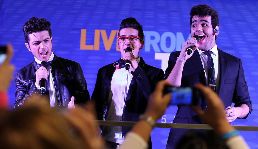 Ignazio Boschetto left, Piero Barone center, and Gianluca Ginoble right, of the group II Volo performs at the Live at T5 at JetBlue terminal 5 at JFK airport on Tuesday, Dec. 4, 2012 in New York. (Donald Traill/Invision/AP)
