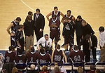Camblesville head coach Keith Adkins talks to his team during a time out during the first half of UK's 74-38 win over the tigers on Nov. 2, 2009.