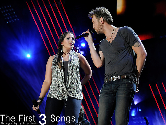 Hillary Scott and Charles Kelley of Lady Antebellum perform at LP Field during the 2011 CMA Music Festival on June 10, 2011 in Nashville, Tennessee.