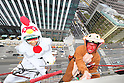 Window cleaners dressed as rooster and monkey wipe the windows of the Hotel Ryumeikan Tokyo, hanging 55.5 meters above ground on December 15, 2016, Tokyo, Japan. This is an annual hand over event where window cleaners dress up as Chinese zodiac animals from the present and the coming year to promote the year-end and New Year. (Photo by AFLO)