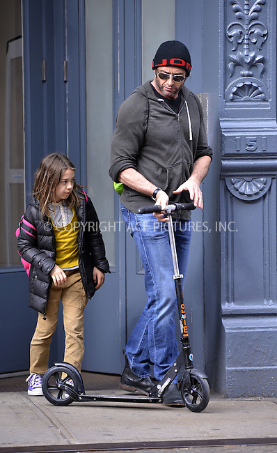 WWW.ACEPIXS.COM....April 22 2013, New York City....Actor Hugh Jackamn walks his daugher Ava home from school on April 22 2013 in New York City....By Line: Curtis Means/ACE Pictures......ACE Pictures, Inc...tel: 646 769 0430..Email: info@acepixs.com..www.acepixs.com