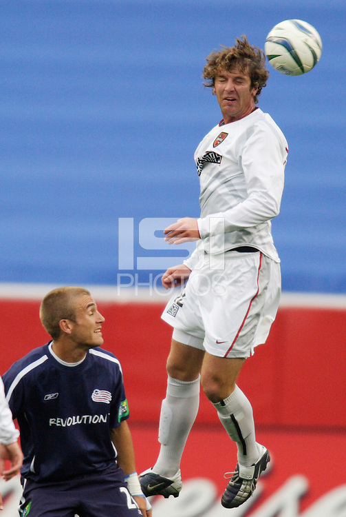 The MetroStars' Jeff Parke goes up for a header as the New England Revolution's Taylor Twellman watches. The New England Revolution tied the NY/NJ MetroStars one all at Gillette Stadium, Foxborough, MA, on May 22, 2004.