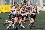 Santa Barbara, CA 02/18/12 - Molly Carstensen (Colorado #14), Avi Feldman  (Cal Poly SLO #17) in action during the 2012 Santa Barbara Shootout.  Colorado defeated Cal Poly SLO 8-7.
